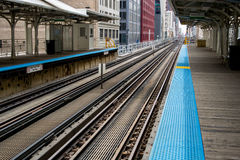 Public Transportation Railway. Blue Nonslip Safety Line Marks the Edge of a Train Station Platform royalty free stock images