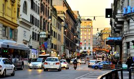 Public transportation on the streets of Rome. Italy with cars, people in traffic. busy day in the city of Roma Royalty Free Stock Photo