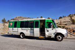 Yosemite National Park Shuttle Bus Transportation. Public transportation in Yosemite National Park - white-green shuttle bus Stock Photos