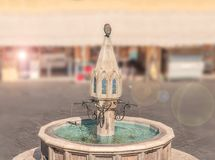 Public view of beautiful fountain in Rhodes town of Greek island. With blurred background and lens flare Royalty Free Stock Photo
