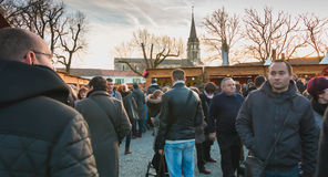 Public walking in the midst of the stalls of the Christmas marke Royalty Free Stock Photography
