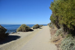 Public walking trail between Dana Strand Beach and Salt Creek Beach in Dana Point, California. Stock Photos