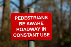 Public warning signs. Placed on foorpaths and roadways Stock Photos