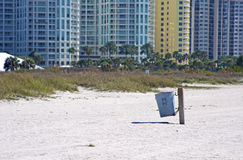 Public waste basket on the beach. Stock Photo