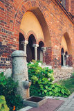 Public Water Fountain inside the inner courtyard of Riga Cathedral. Royalty Free Stock Image