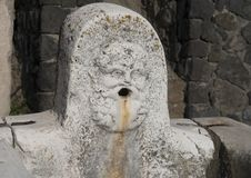 Public water fountain in the remains of Herculaneum Parco Archeologico di Ercolano. Pictured is a public water fountain in the remains of Herculaneum in the Royalty Free Stock Photos
