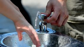 Public water sink. In a hot day stock video footage