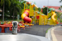 Public water tap. Coldwater tap in blackground playground Stock Photo