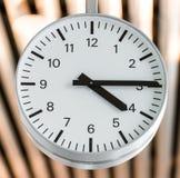 Public white round clock. Stock Image