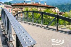 Public wifi bridge in Bressanone rivet bridge with wifi symbol o Stock Photos