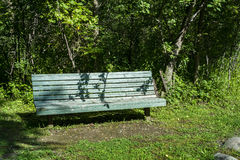 Public wood bench. In the forest stock photos
