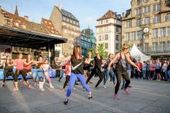 Public Zumba performance. STRASBOURG, FRANCE - APRIL 24, 2016: Zumba public performance in the central square of the city of Strasbourg, - Place Kleber Royalty Free Stock Photo