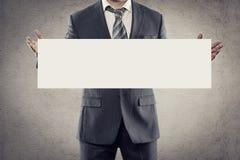 Publicidad del hombre de negocios Imagen de archivo libre de regalías