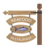 Publicité de fruits de mer de restaurant sur les conseils en bois Photo stock