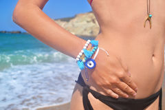publicité grecque de bijoux sur la plage Photographie stock libre de droits