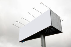 Publicity board. On grey sky stock images