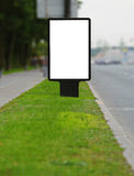 Publicity board on a roadside. Vertical publicity board on a sward along street Royalty Free Stock Images