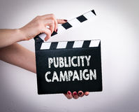 Publicity Campaign. Female hands holding movie clapper.  royalty free stock photo