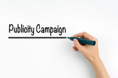Publicity Campaign. Hand with marker writing on a white background.  royalty free stock image