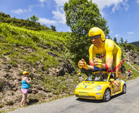 Publicity Caravan in Pyrenees. Col de Val Louron-Azet, France- July 07,2013:LCL (Le Credit Lyonnais) car and the specific cyclist mascot during the passing of Stock Photography
