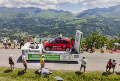 Publicity Caravan in Pyrenees. Col de Val Louron-Azet, France- July 07,2013:Truck transporting a Skoda car during the passing of the publicity caravan on the Stock Image