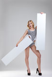 Publicity stunt. Beautiful girl on a gray background with banners and arrows stock photos