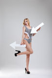 Publicity stunt. Beautiful girl on a gray background with banners and arrows royalty free stock photos
