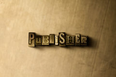 PUBLISHER - close-up of grungy vintage typeset word on metal backdrop Stock Photos