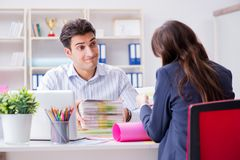 Pulisher discussing book order with customer. Publisher discussing book order with customer Stock Photography