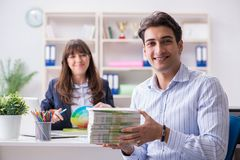 Pulisher discussing book order with customer. Publisher discussing book order with customer Royalty Free Stock Image