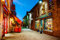 Pubs in Kilkenny, Ireland at night. KILKENNY, IRELAND - NOVEMBER 22, 2014: Famous place in the city where stand in a row different bars and pubs. Kilkenny is a Stock Images