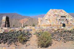 Pucara Fortification. Pucara de Tilcara, a precolumbian fortress city, embedded into the colorful mountain landscape of the Quebrada de Humahuaca valley in Jujuy Stock Photos