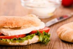 Puccia bread with mozzarella and tomato. Stock Image
