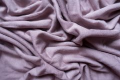 Puce fabric with folds from above. Puce colored fabric with folds from above Stock Image