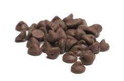 Puces de chocolat sur le fond blanc Image stock