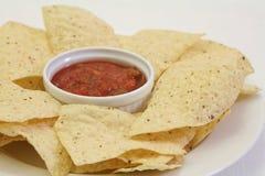 Puces de Nacho avec le Salsa Photo libre de droits