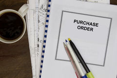 Puchased order. Complete with plans and morning coffee Stock Image