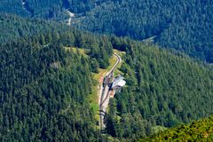 PUCHBERG, AUSTRIA, - AUGUST 9, 2018: Aerial view from Schneeberg mountain to rack railway named Salamander station. stock photos