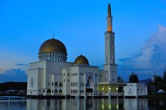 Puchong Perdana Mosque. S in Malaysia. nThe mosque floats on the lake, it is a floating mosque. The reflection of the mosque can be seen on the lake. The picture Stock Photo