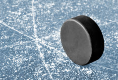 Puck. Hockey puck on ice rink Royalty Free Stock Photography