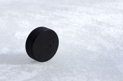Puck on the edge. A black puck on the edge Stock Photos