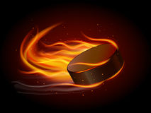 Puck In Fire Royalty Free Stock Photos