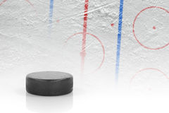 Puck and hockey field with markings Royalty Free Stock Photo