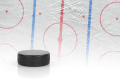 Puck and hockey field Stock Photo