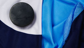Puck on a hockey jersey Stock Image