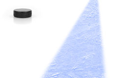 Puck on a hockey rink Stock Photos