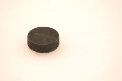 Puck on Ice Stock Images