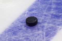 Puck on ice hockey rink surface, sport background stock image