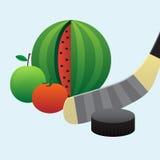 Puck och frukt Arkivbild