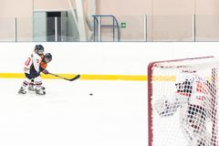 Puck playing between players of ice-hockey teams Royalty Free Stock Images